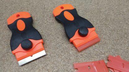 Plastic or Metal razor scraper